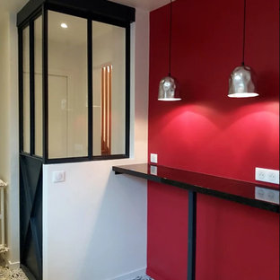 Inspiration for a mid-sized contemporary enclosed ceramic floor and multicolored floor family room remodel in Paris with red walls