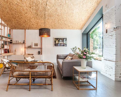 Inspiration pour une salle de séjour design ouverte avec un mur blanc aucune cheminée et