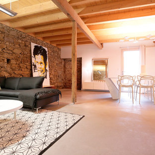 Family room - large contemporary open concept concrete floor family room idea in Angers