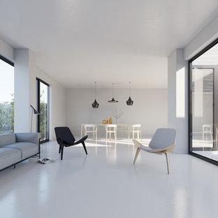 Idée de décoration pour une grand salle de séjour design ouverte avec un mur blanc, aucune cheminée et aucun téléviseur.