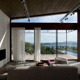 Inspiration pour une salle de séjour design de taille moyenne et fermée avec un mur blanc et une cheminée ribbon.