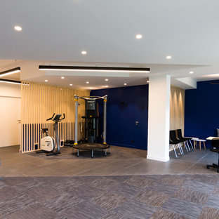 75 most popular home gym with blue walls and ceramic