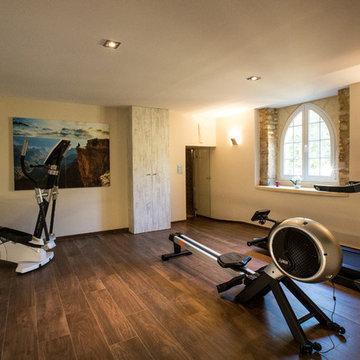 La salle de fitness au sous-sol du château