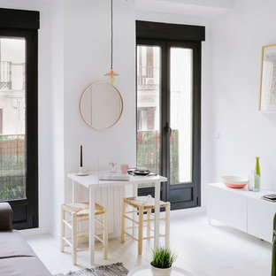 This is an example of a small scandinavian formal open plan living room in Madrid with white walls, painted wood flooring, no fireplace and no tv.