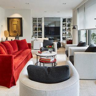 Ejemplo de salón para visitas abierto, contemporáneo, de tamaño medio, con paredes blancas, chimenea lineal y televisor colgado en la pared