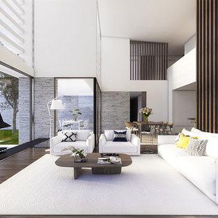 Foto di un grande soggiorno contemporaneo aperto con sala formale, pareti bianche, pavimento in legno massello medio, camino sospeso e nessuna TV