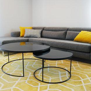 Ispirazione per un soggiorno minimalista aperto con pareti bianche, pavimento in gres porcellanato, nessun camino, TV autoportante e pavimento grigio