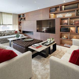 Imagen de salón para visitas cerrado, actual, con paredes marrones, moqueta, chimenea lineal, marco de chimenea de madera, pared multimedia y suelo beige
