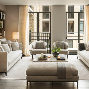 Inspiration for a contemporary living room in Palma de Mallorca with grey walls, dark hardwood flooring and brown floors.