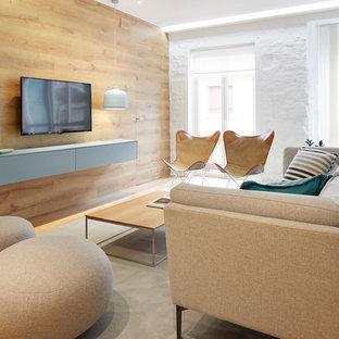 Ejemplo de salón abierto, nórdico, con paredes blancas y televisor colgado en la pared