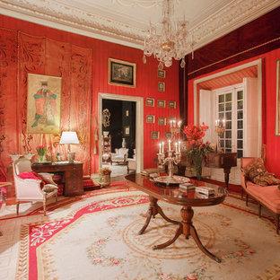 Ejemplo de salón para visitas cerrado, clásico, grande, sin chimenea y televisor, con paredes rojas y moqueta