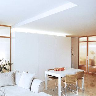 Foto de salón abierto, actual, de tamaño medio, sin chimenea y televisor, con paredes blancas, suelo de mármol y suelo rosa