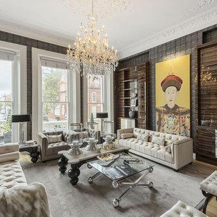 Diseño de salón para visitas abierto, contemporáneo, sin televisor, con paredes grises, suelo de madera clara y suelo beige