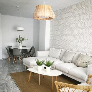 Imagen de salón abierto, nórdico, con paredes multicolor y suelo gris