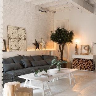 Imagen de salón para visitas abierto, nórdico, de tamaño medio, sin televisor, con paredes blancas y suelo de madera pintada