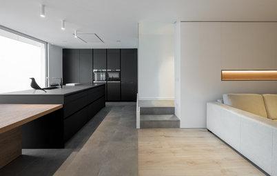 Una cocina elegante y funcional define una amplia zona de día