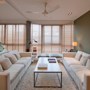 Imagen de salón para visitas cerrado, escandinavo, de tamaño medio, sin chimenea y televisor, con moqueta y paredes verdes