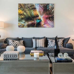 Imagen de salón para visitas abierto, contemporáneo, grande, sin chimenea, con paredes blancas y suelo de baldosas de porcelana