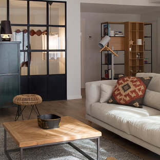 Medium sized enclosed living room in Barcelona with brown walls, medium hardwood flooring, no fireplace, a wall mounted tv and brown floors.