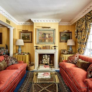 Ejemplo de salón clásico con paredes amarillas, moqueta, chimenea tradicional y suelo azul
