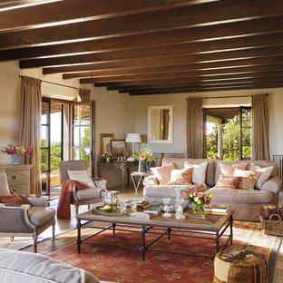 Diseño de salón para visitas cerrado, mediterráneo, grande, con paredes beige, suelo de piedra caliza y suelo beige
