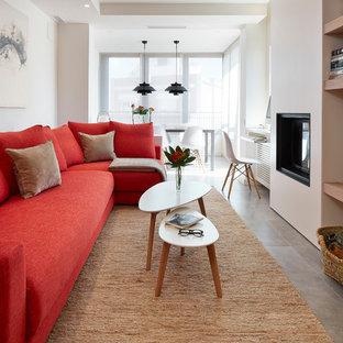 Immagine di un soggiorno minimal di medie dimensioni e aperto con sala formale, pareti bianche, pavimento con piastrelle in ceramica, stufa a legna e parete attrezzata