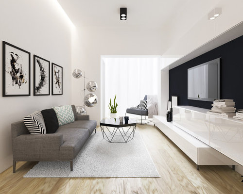 Example of a small minimalist open concept light wood floor living room  design in Brussels with