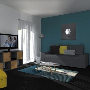 Foto di un soggiorno scandinavo di medie dimensioni e aperto con pareti blu, parquet scuro e pavimento nero