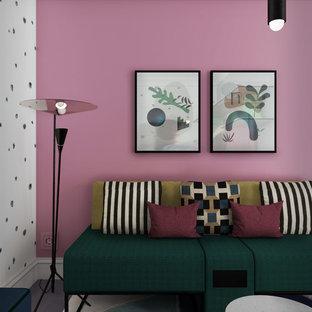Foto di un piccolo soggiorno minimalista aperto con libreria, pareti blu, pavimento in cemento, nessun camino, nessuna TV e pavimento grigio