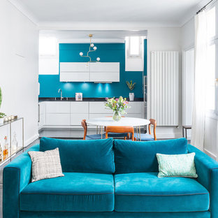 This is an example of a mid-sized contemporary open concept living room in Paris with blue walls, painted wood floors and black floor.