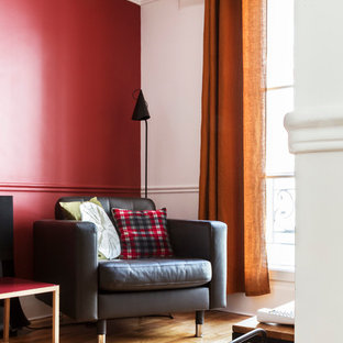 Design ideas for a medium sized contemporary open plan living room in Paris with a reading nook, red walls, light hardwood flooring, a wall mounted tv and no fireplace.