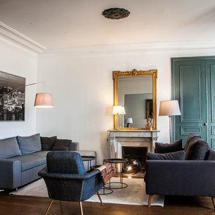 Aménagement d'un salon classique ouvert et de taille moyenne avec une salle de réception, un mur blanc, un sol en bois foncé, une cheminée standard, un manteau de cheminée en pierre et aucun téléviseur.