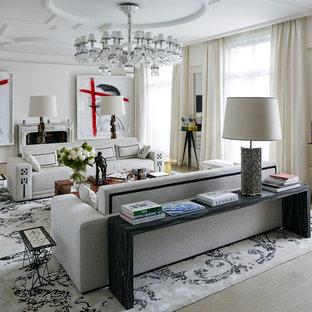 Inspiration pour un très grand salon design ouvert avec une salle de réception, un mur blanc, un sol en bois clair, une cheminée standard, aucun téléviseur et un sol beige.