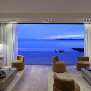 Esempio di un grande soggiorno contemporaneo aperto con libreria, parete attrezzata, pavimento marrone, pareti bianche, pavimento in linoleum e camino bifacciale