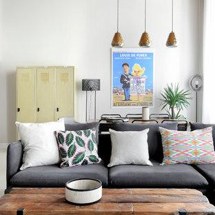 Inspiration pour un salon nordique ouvert avec un mur blanc.
