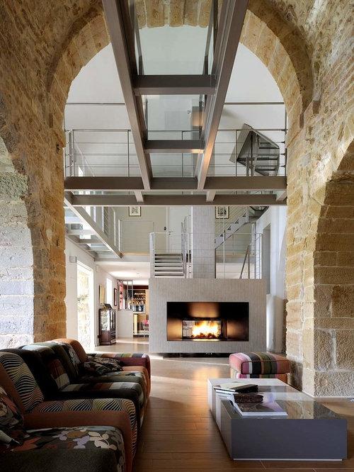 industrial wohnzimmer mit tunnelkamin design ideen. Black Bedroom Furniture Sets. Home Design Ideas