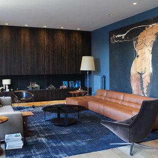 Esempio di un grande soggiorno design chiuso con sala formale, pareti blu, parquet chiaro, nessun camino e nessuna TV