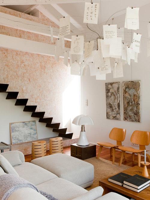 Exemple dun petit salon scandinave avec une salle de réception un mur blanc