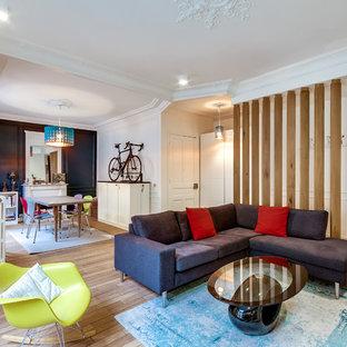 Inspiration pour un grand salon design ouvert avec un mur blanc, un sol en bois clair, une salle de musique, une cheminée standard, un manteau de cheminée en pierre et aucun téléviseur.