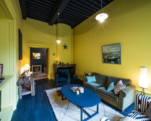 Salon avec un mur jaune photos et id es d co de salons for Salon jaune et bleu