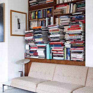 Inspiration pour un salon design avec un mur blanc et moquette.