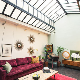 Idées déco pour un salon éclectique ouvert avec béton au sol, aucune cheminée et aucun téléviseur.