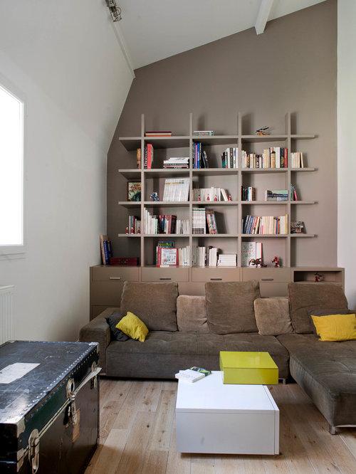 Trendy Medium Tone Wood Floor Living Room Photo In Paris With Beige Walls