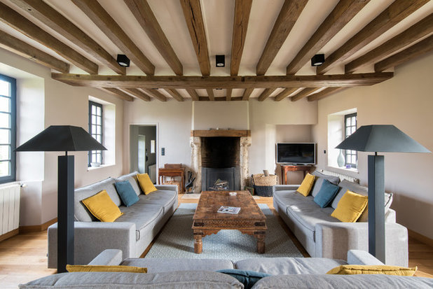 Farmhouse Living Room by LES CHANTIERS COTTIN