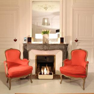 Inspiration pour un salon design de taille moyenne et fermé avec une salle de réception, un mur blanc, un sol en bois peint, une cheminée standard, un manteau de cheminée en pierre et aucun téléviseur.