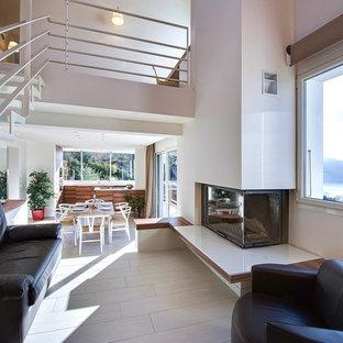 Inspiration pour un salon minimaliste ouvert et de taille moyenne avec un mur blanc, un sol en carrelage de céramique, une cheminée standard et aucun téléviseur.