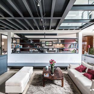 Réalisation d'un salon urbain de taille moyenne et ouvert avec une salle de réception, un mur blanc, béton au sol, aucune cheminée et aucun téléviseur.