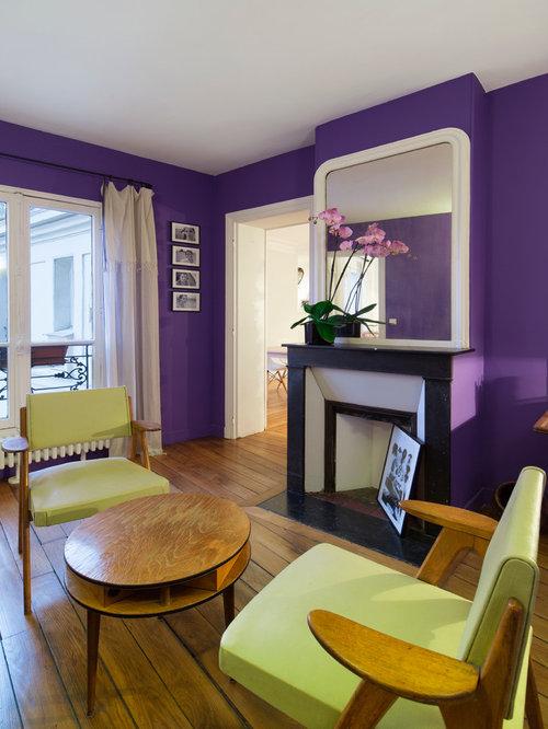 Soggiorno con camino ad angolo e pareti viola - Foto e Idee per ...