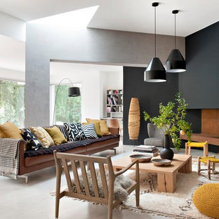 Idées déco pour un salon contemporain avec un mur multicolore et béton au sol.