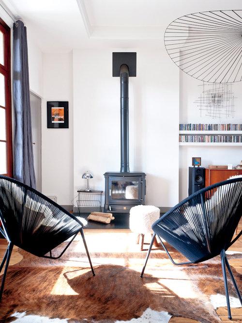 Salon avec un po le bois photos et id es d co de salons for Idee deco poele a bois